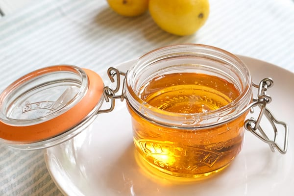 golden syrup inside a small glass jar with an open lid