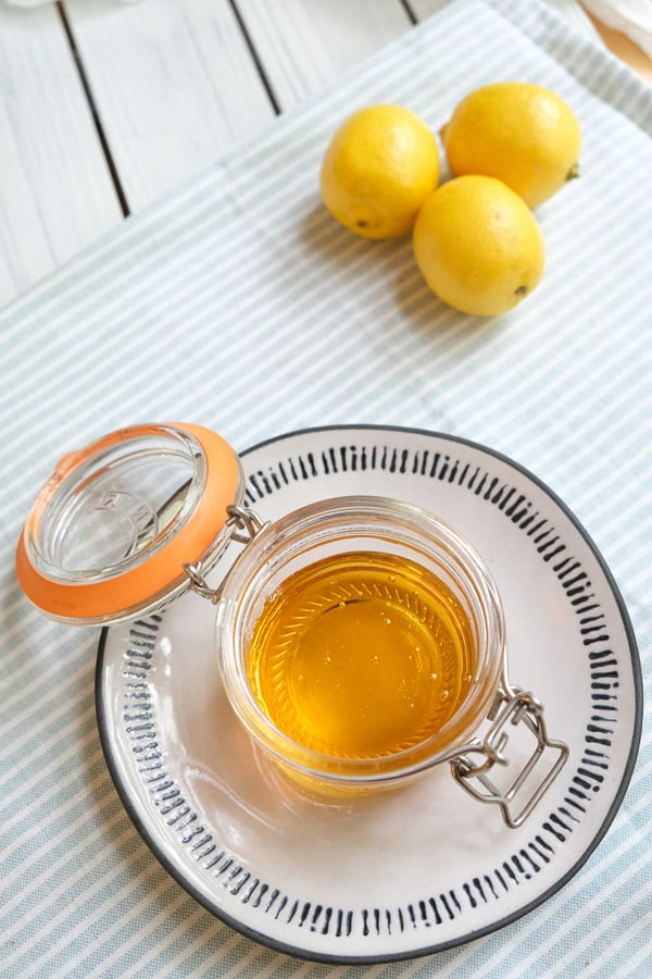 top view of golden syrup in a jar with open lid
